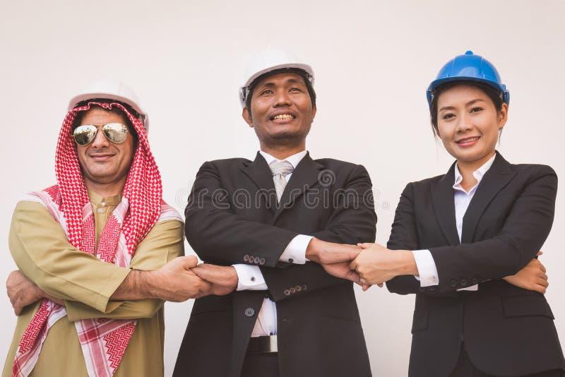 Arquiteto e trabalhador do coordenador de construção da equipe do negócio teamwork fotografia de stock royalty free