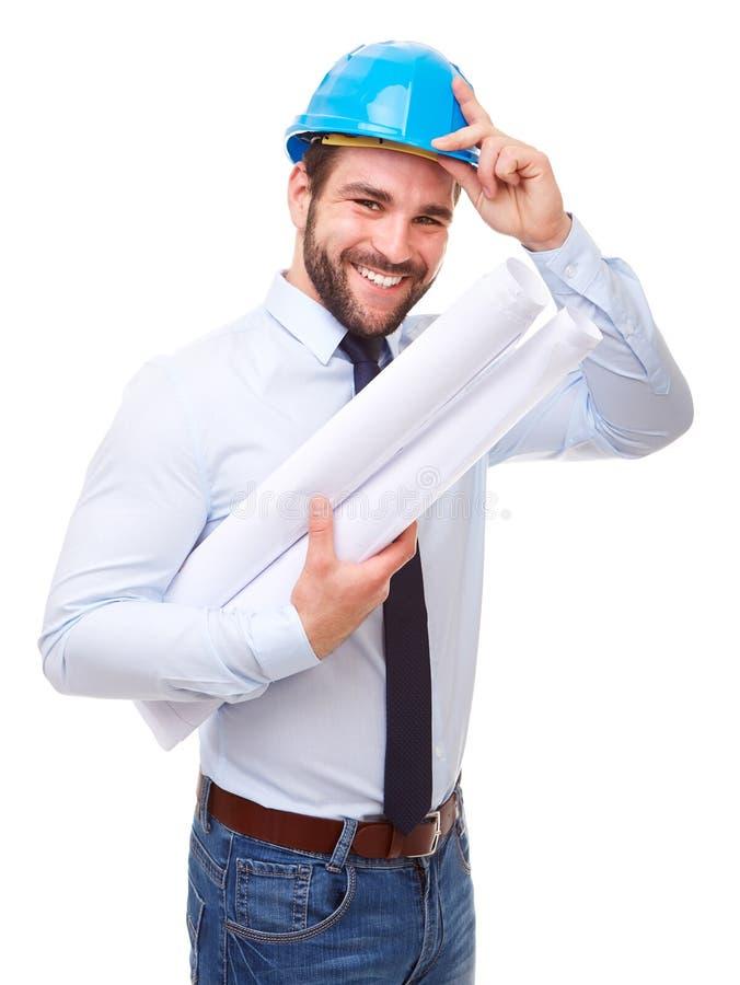 Arquiteto feliz com capacete de segurança fotografia de stock royalty free