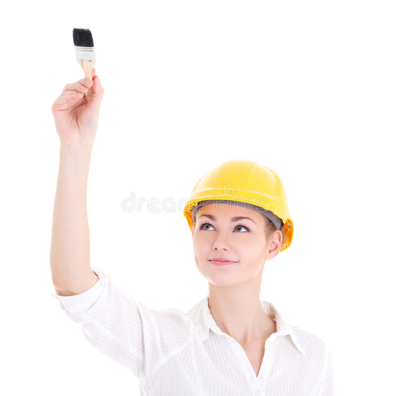 Arquiteto feliz da mulher de negócio na pintura amarela do capacete do construtor fotografia de stock royalty free