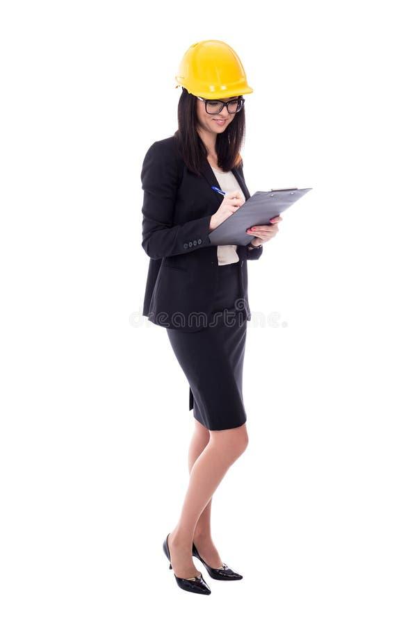 Arquiteto feliz da mulher de negócio no capacete amarelo com prancheta mim fotografia de stock