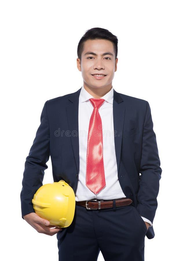 Arquiteto novo asiático do homem de negócios no fundo branco imagens de stock royalty free