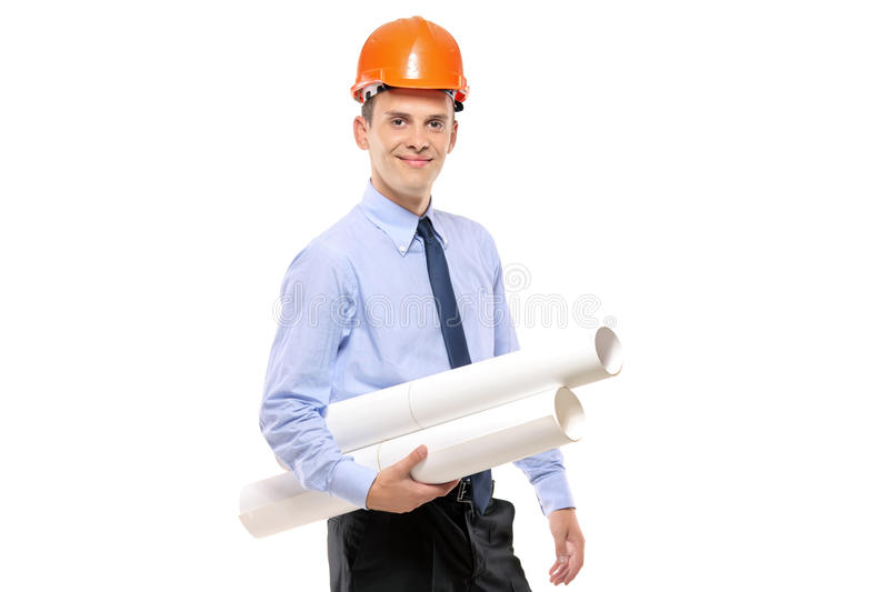 Arquiteto novo que desgasta o capacete protetor foto de stock
