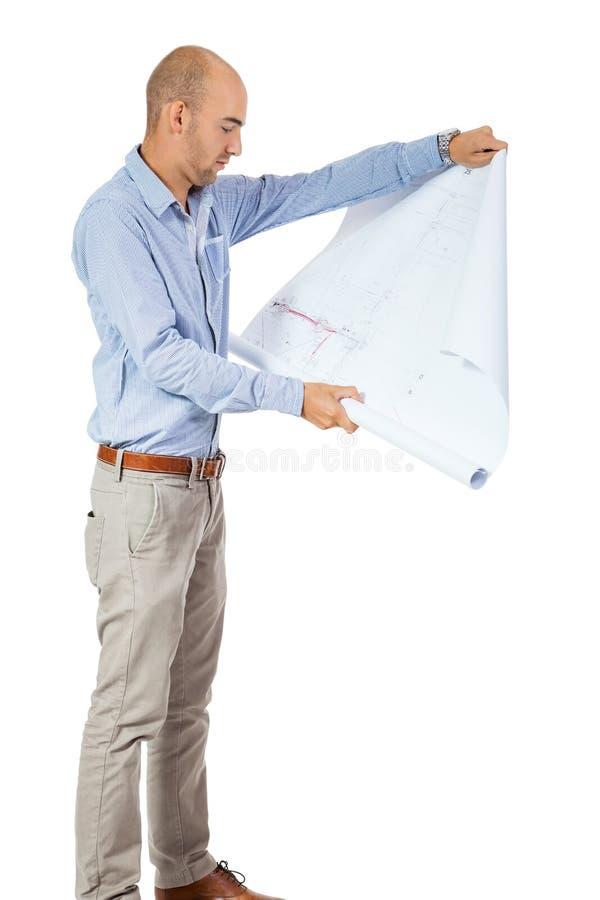 Arquiteto que lê um modelo imagens de stock