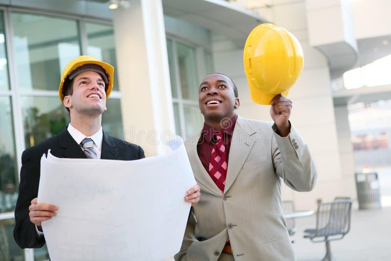 Arquitetos consideráveis dos homens foto de stock