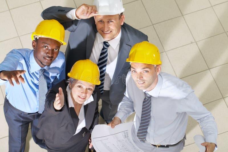 Arquitetos contentes em seu trabalho imagens de stock