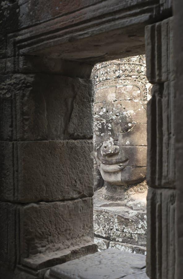 Arquitetura da cara do deus em Angkor Wat fotografia de stock royalty free