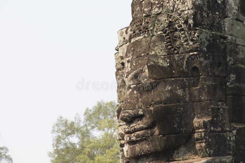 Arquitetura da cara do deus em Angkor Wat imagem de stock