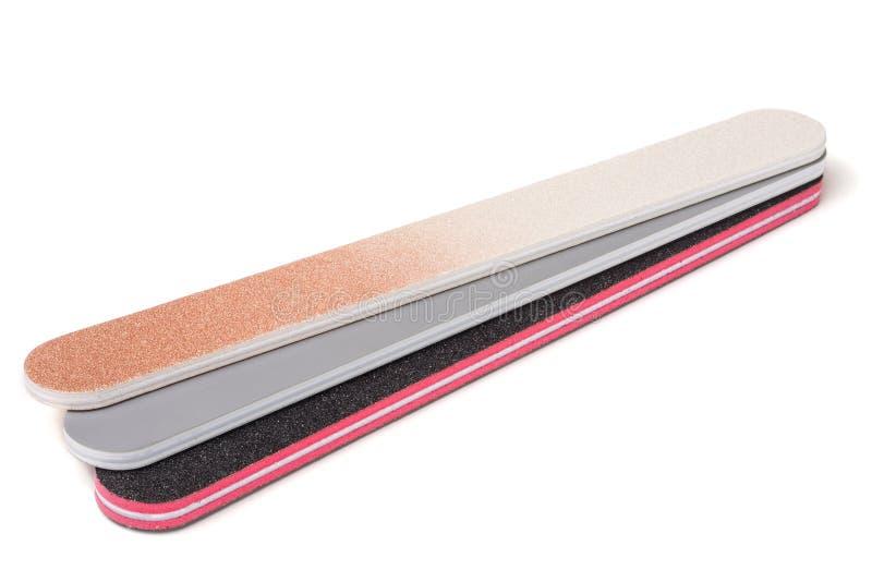 Arquivo de prego três com um abrasivo diferente isolado no fundo branco imagem de stock