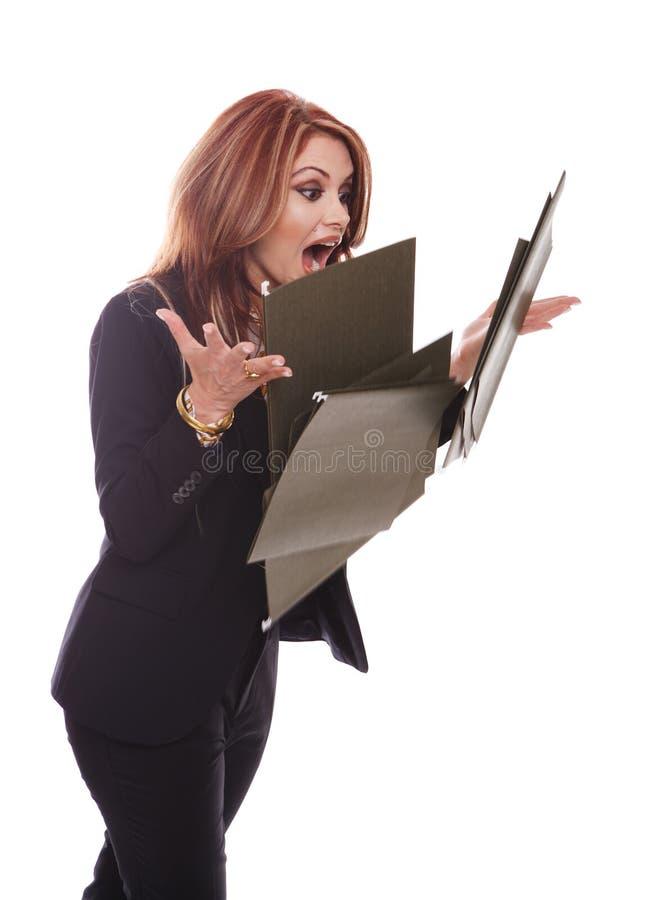 Arquivos deixando cair da mulher de negócios imagem de stock royalty free