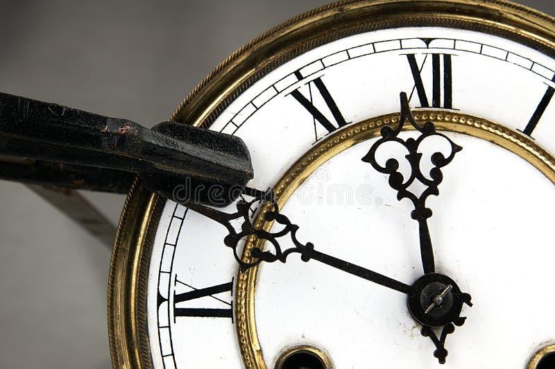 Arrêt de bride de charpentier l'horloge photos libres de droits