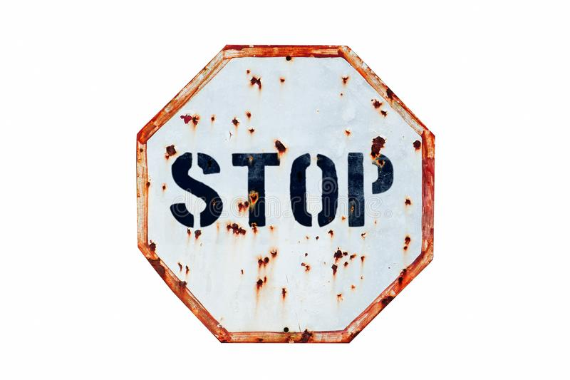 Arrêtez écrit dans les lettres audacieuses dans vieux un signe de circulation routière blanc et rouge rouillé et sale photographie stock libre de droits