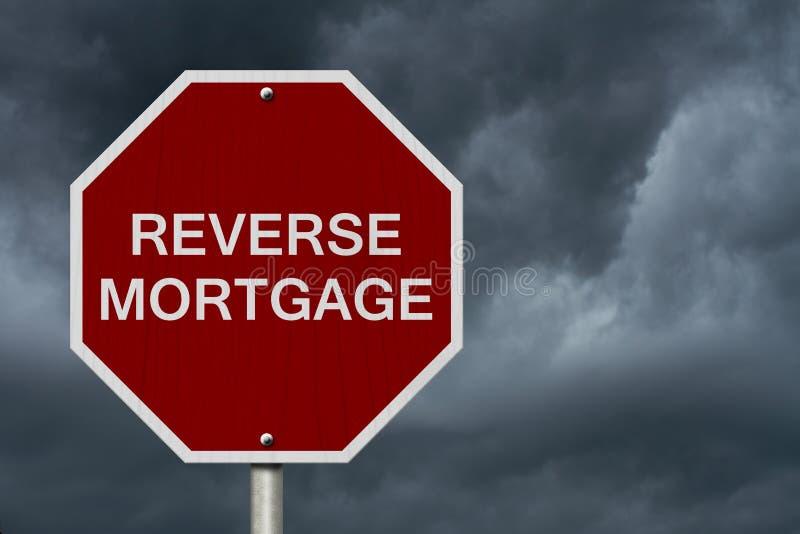 Arrêtez le panneau routier inverse d'hypothèque photographie stock libre de droits