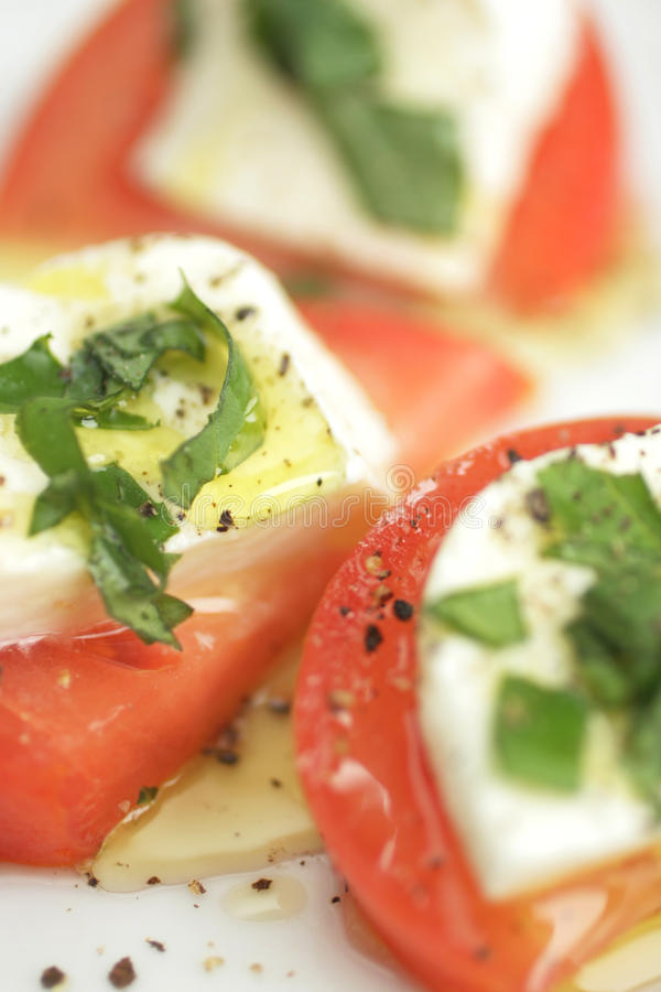 Arrancador del tomate y de queso foto de archivo