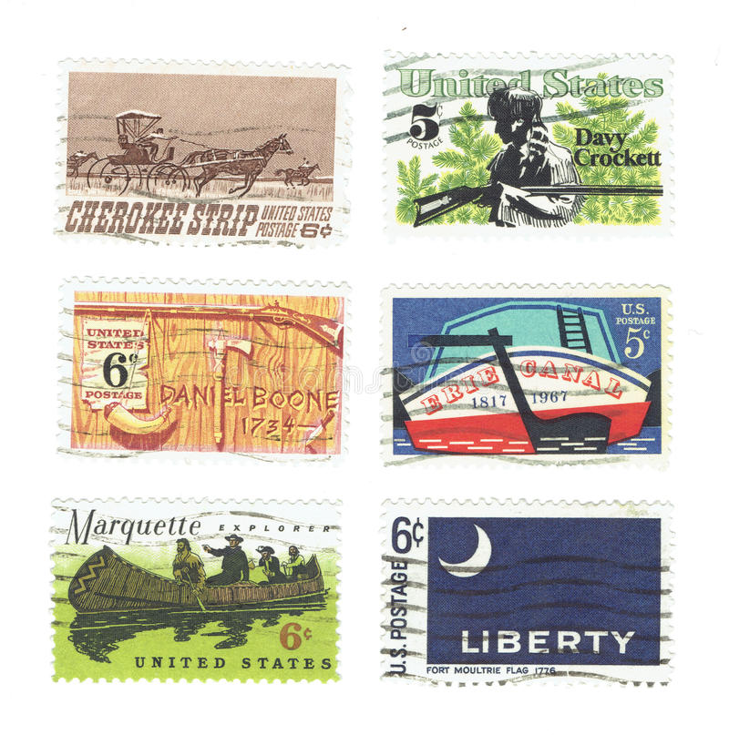 Arrange of used postage stamps printed in USA shows Stern of Erie Canal, Cherokee Strip of Kansas, Davy Crockett and Daniel Boone stock photos