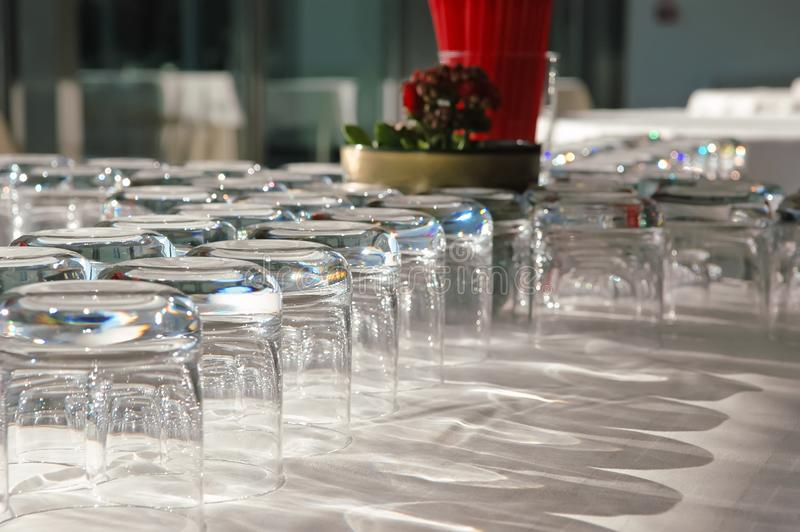 Arranged empty glasses on the table with white cloth in restaurant royalty free stock photo