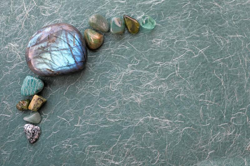 Healing Labradorite and green crystal selection background stock photos