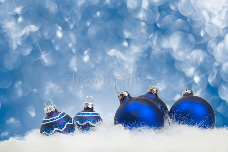 Arrangement of blue Christmas ornaments on blue background royalty free stock photos
