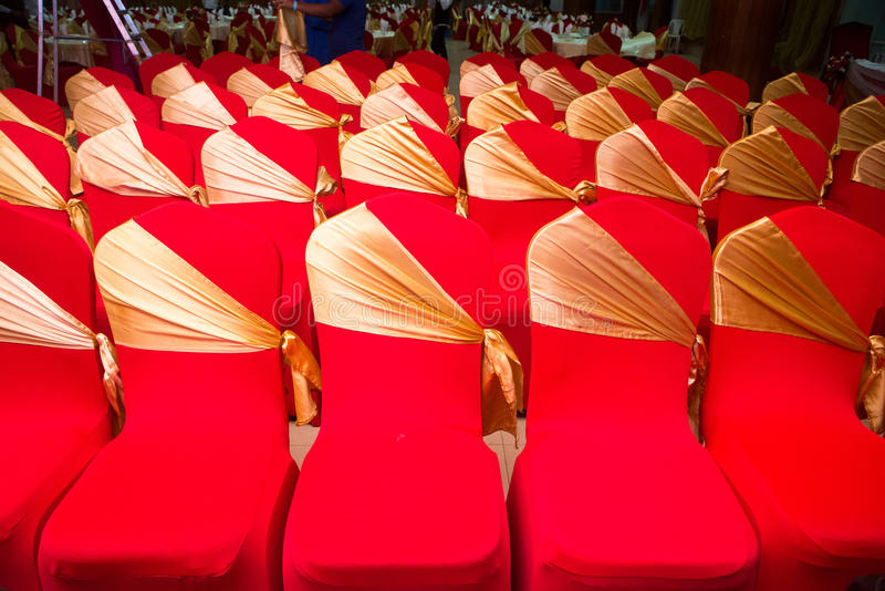 Arrangement the chairs with ref cloths with golden view. This is created by people can sit there royalty free stock photography