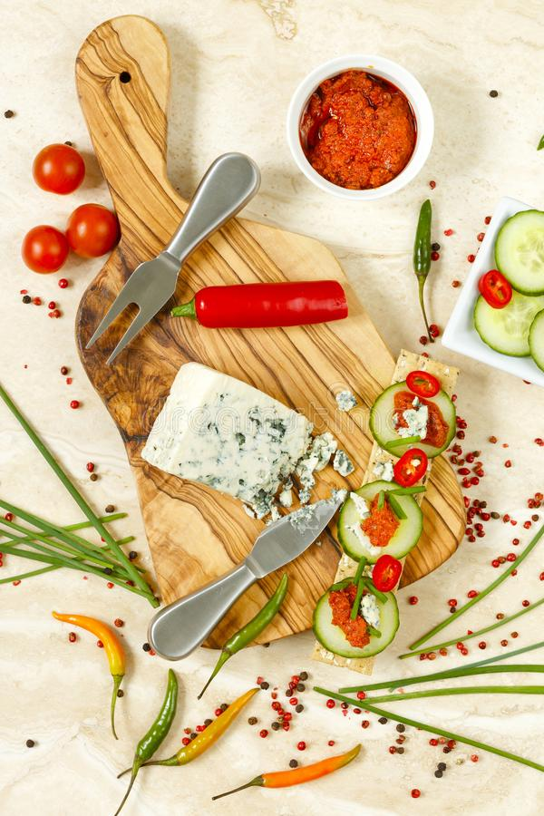 Arrangement of cheese cracker snack with tomato pesto royalty free stock images