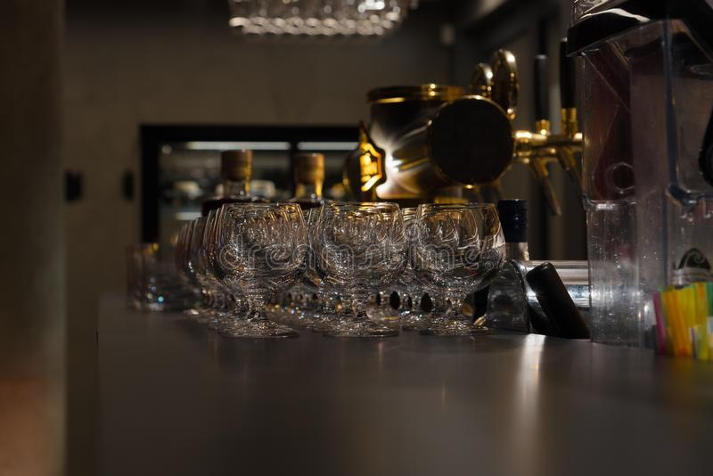 Cognac glasses at the bar counter royalty free stock images