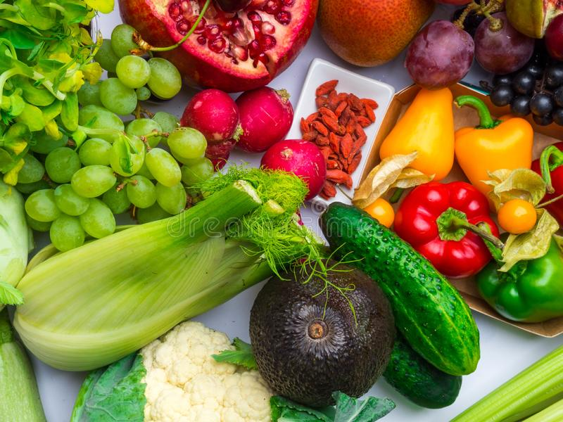 Arrangement of different colorful tasty vegetables fruits rich in vitamin, antioxidants background. Horizontal. Healthy Food royalty free stock image