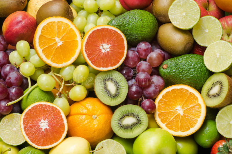 Arrangement fresh fruits and vegetables background. Arrangement fresh fruits slice and vegetables background stock photos