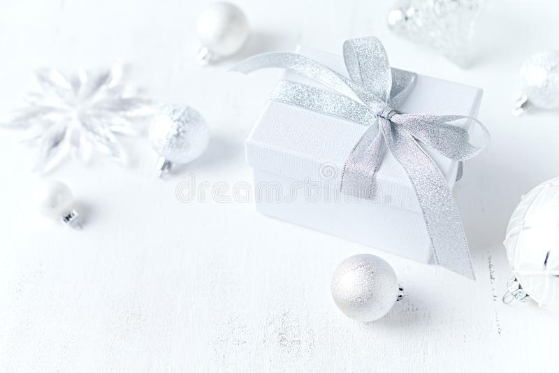 An arrangement of gift boxe and Christmas decorations on white background. Symbolic image. Close up. Copy space royalty free stock image