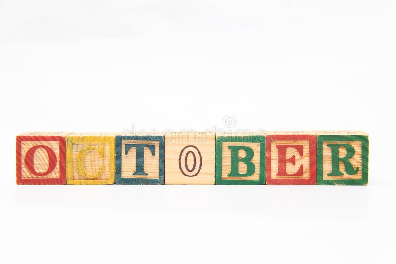 The arrangement of letters forms one word, version 136. The arrangement of letters forms one word, composing letters into one word, OCTOBER royalty free stock photography