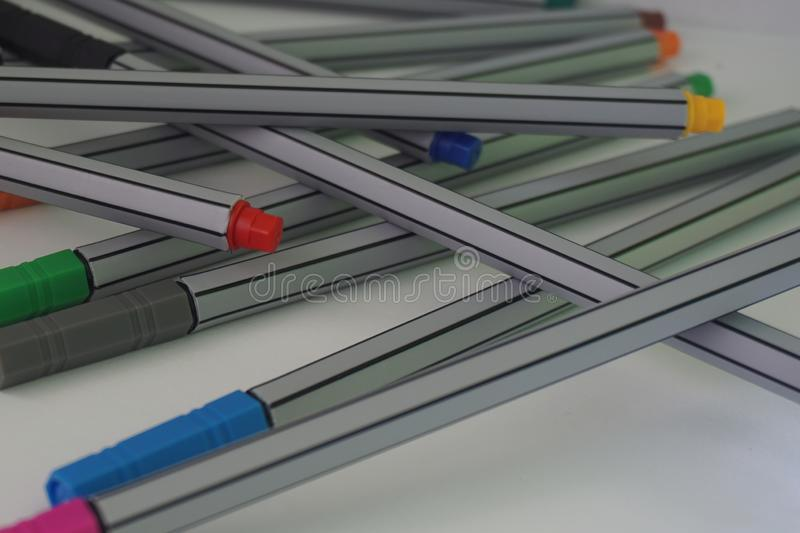 Close up of an arrangement of colourful pens royalty free stock image