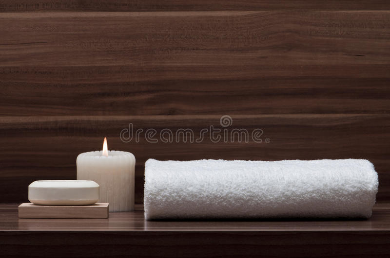 Arrangement of soap, towel and candle royalty free stock image