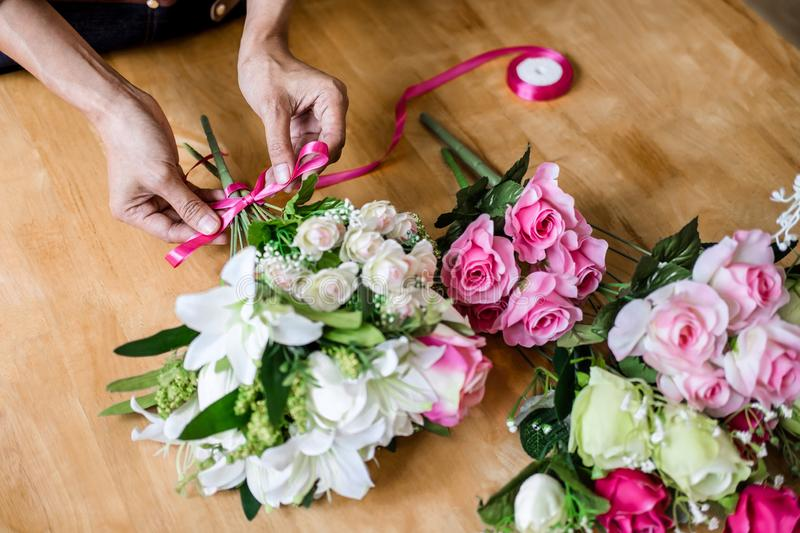 Arranging artificial flowers vest decoration at home, Young woman florist work making organizing diy artificial flower, craft and. Hand made concept royalty free stock photography
