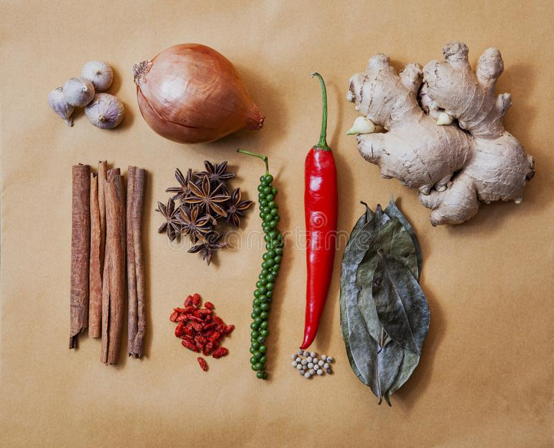 Arranging of beautiful natural asian spice and healthy herb on earth tone papaer background royalty free stock images
