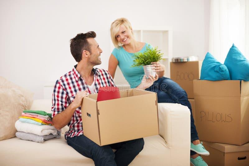 Arranging a new apartment. Couple arranging a new flat stock photo