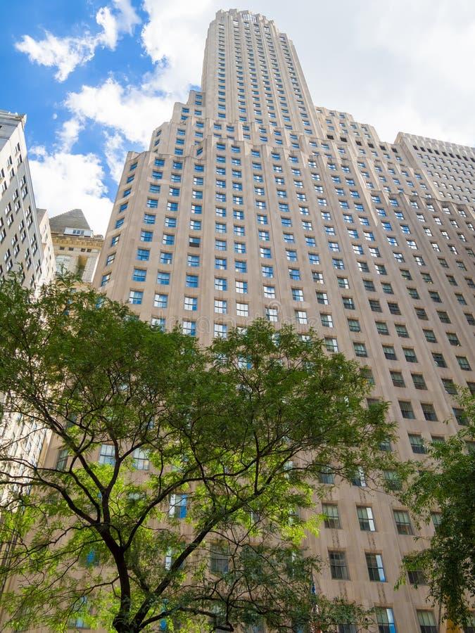Arranha-céus no canto de Broadway e de Wall Street em New York fotos de stock
