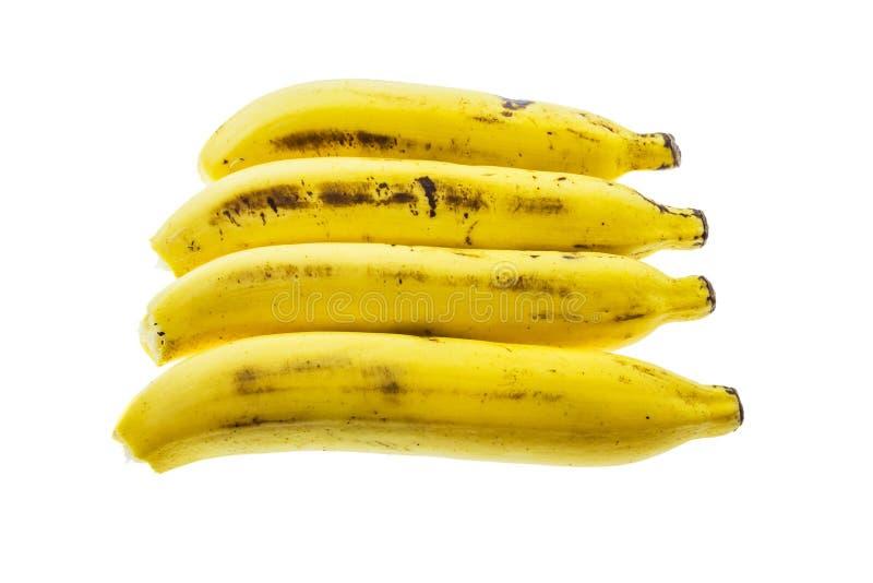 Arranjo horizontal de muitas bananas isolado no fundo branco fotos de stock royalty free