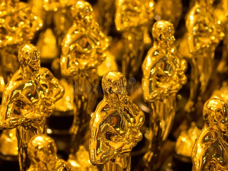 Array of golden statues stock photos