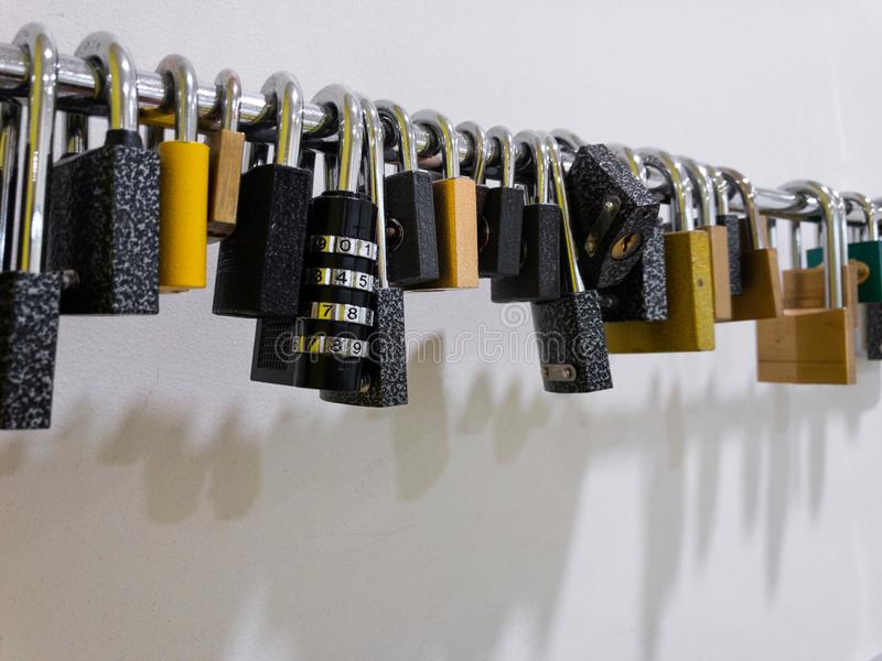 Array of pad locks hanging in a gym on the wall stock photography