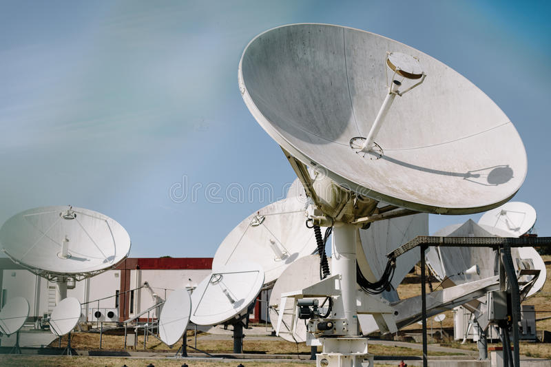 Array of satellite dishes stock images