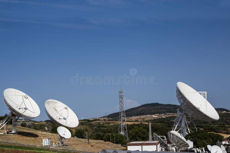 Array of satellite dishes royalty free stock photo
