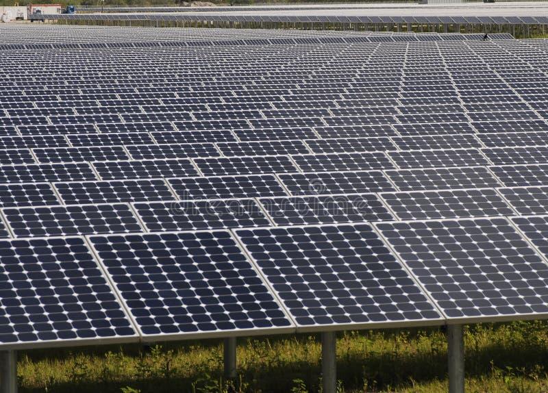 Array of solar panels stock photos