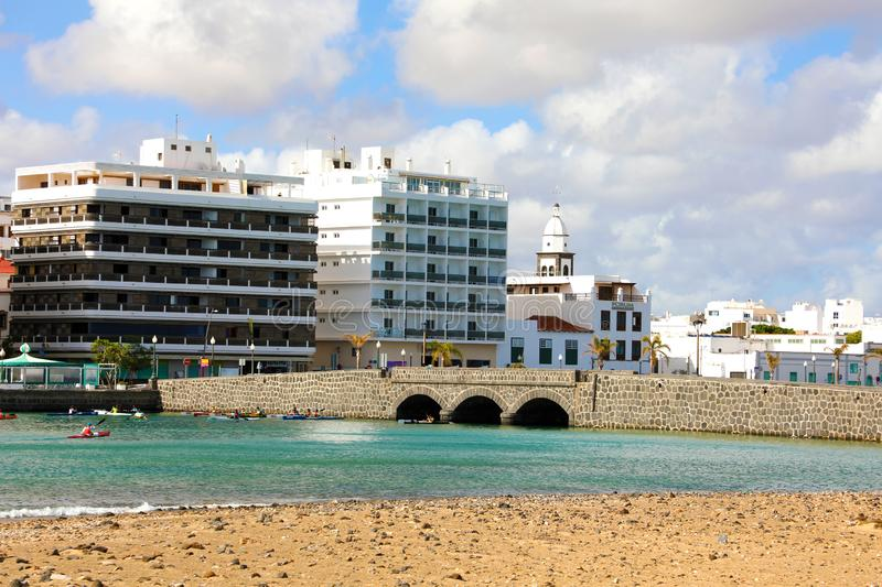 ARRECIFE, SPAIN - APRIL 20, 2018: Arrecife seafront with palm tr. Ees and buildings, Lanzarote, Spain stock images