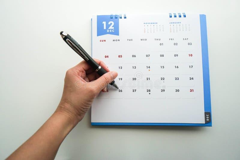 Arregle resolver en diciembre el calendario imágenes de archivo libres de regalías