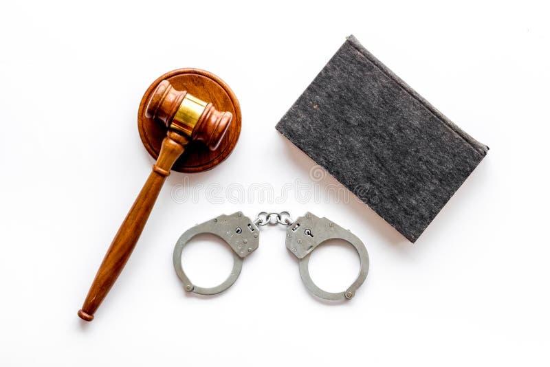 Arrest concept. Handcuffs near judge gavel on white background top-down.  stock photos