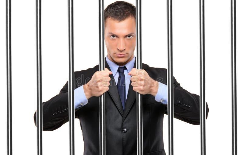 arrest för stångaffärsmanholding arkivfoton