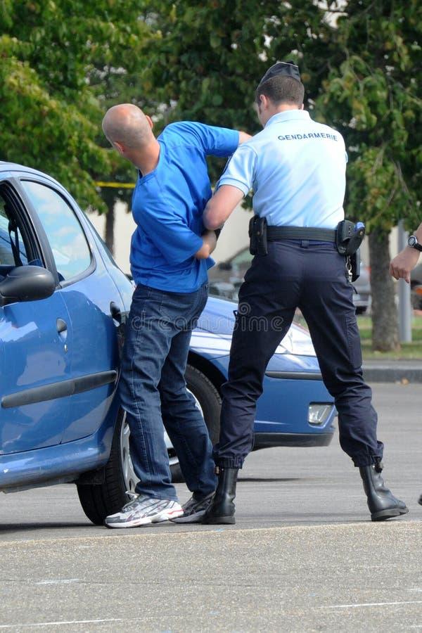 Arrestato dai gendarmi fotografia stock