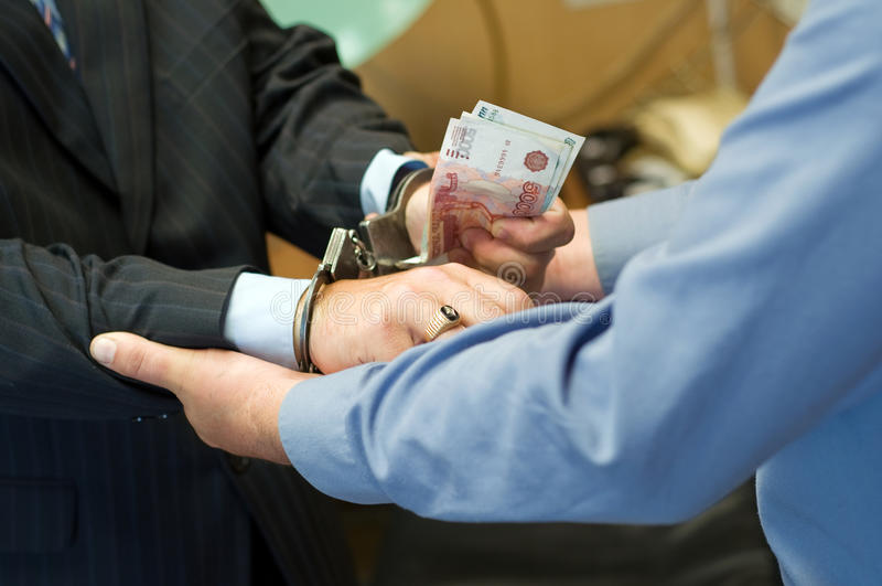 It is arrested at bribe reception stock photos