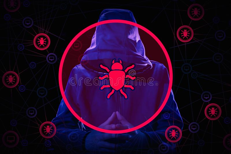 Arrested computer hacker and cyber criminal with handcuffs wearing hooded jacket hiding face. On network background with worms and virus concept stock photo