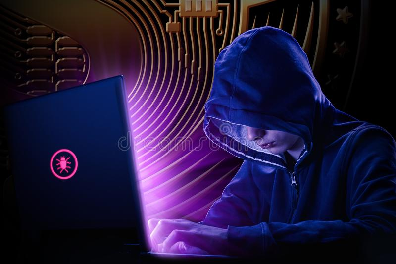 Arrested computer hacker and cyber criminal with handcuffs wearing hooded jacket hiding face royalty free stock images