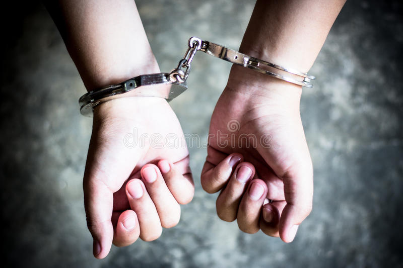 Arrested. Criminal in handcuffs arrested for his crimes royalty free stock photos