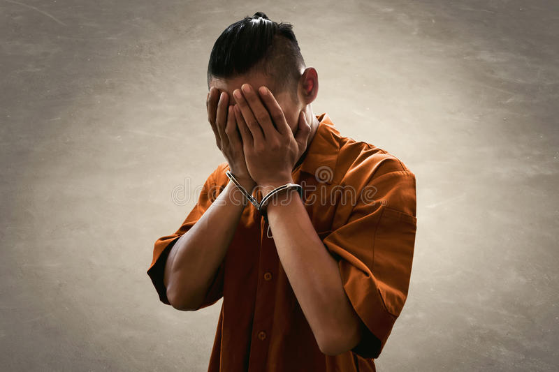 Arrested man in handcuffs stock images